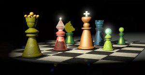 Bild: bunte Schachfiguren auf Schachbrett