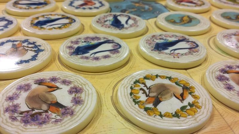 Bild Spielsteine mit abgebildeten Vögeln