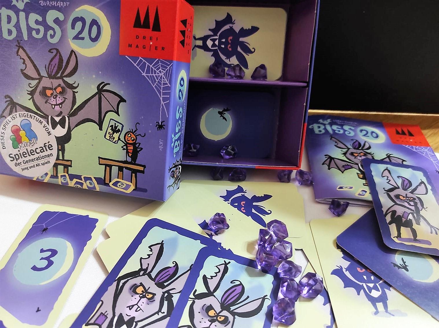 Das Spiel ist in violetten Tönen gestaltet und zeigt die Karten und Edelsteine.