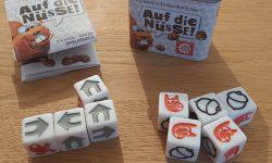 Zu sehen ist das Spiel Auf die Nüsse samt Inhalt.